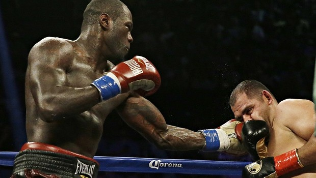 Deontay Wilder catches Eric Molina with a left during his successful world title defence.